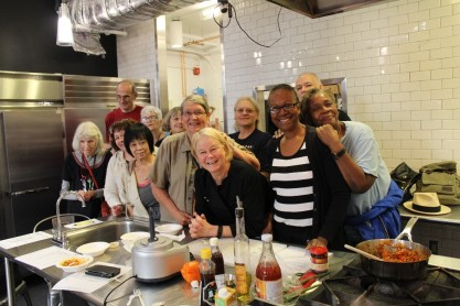 Cooking class participants and Chef Diane LaVonne celebrate delicious food and great company.