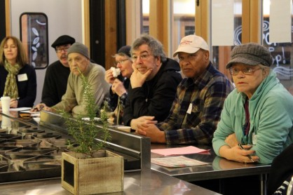 Cooking class participants watch a free demonstration in the Atrium Kitchen